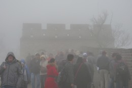 5 a) A Lookout Tower at The Great Wall of China in a heavy fog