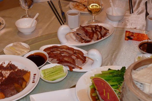 8 c) The Peking Duck platters on our table