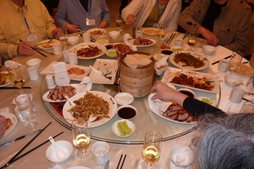 8 d) The round turntable, with Peking Duck and other Chinese foods on it, makes for easy serving