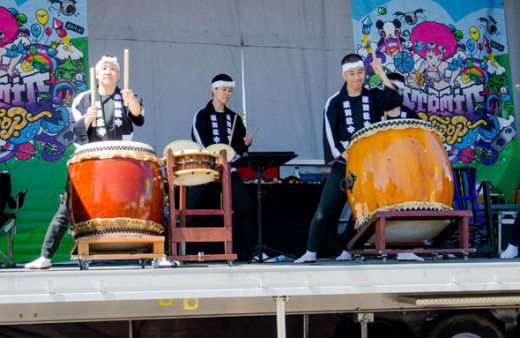 Taiko Drummers beating out a tune.