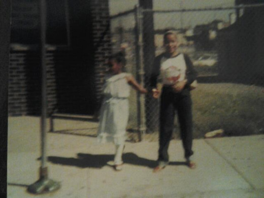 My little sister Keshia about 9 and me about 20!