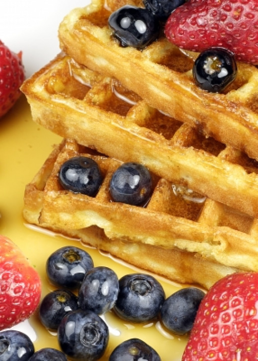 Belgian waffles with blueberries, strawberries and maple syrup