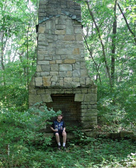 Cabin ruins in the woods along the hiking trail.