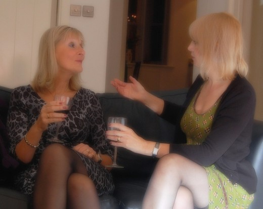 Both of these women are actively engaged in the conversation taking place. Note the openness of  their hands and arms; eye contact is being made and they are facing toward one another.