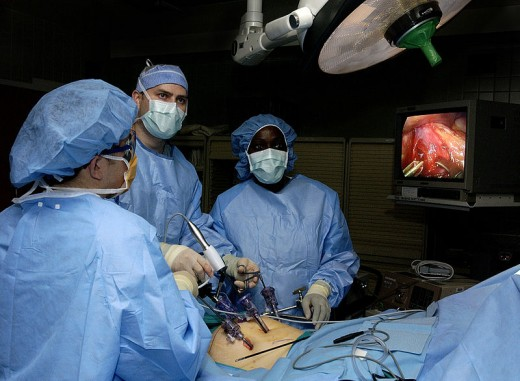 Physicians perform laparoscopic stomach surgery. The surgery will involve the removal of the gall bladder to help alleviate acid reflux disease.