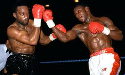 Chris Eubank battles it out with his long standing rival Nigel Benn. All three of their  bouts were closely contested.