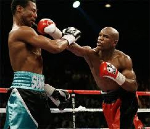 Floyd Mayweather punishes Sugar Shane Mosley in a 12 round decision win which was fought in the welterweight division.