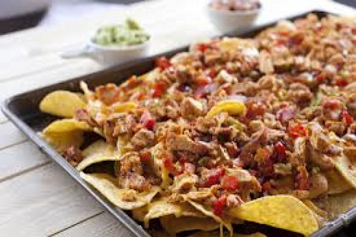 Fajita Nachos can be served with black beans, rice, sour cream, olives, and whatever other toppings that you like on your nachos.