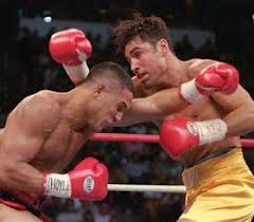 A past his prime Hector Camacho loses a 12 round decision to the Golden Boy Oscar De La  Hoya. De La Hoya successfully defended his welterweight title.
