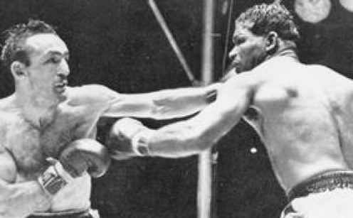 Carmen Basilio fights it out with rival Sugar Ray Robinson.