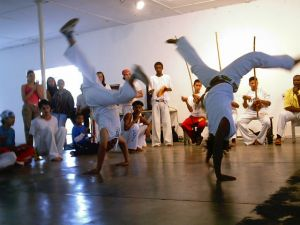 Capoeira - these movements can fit parkour.