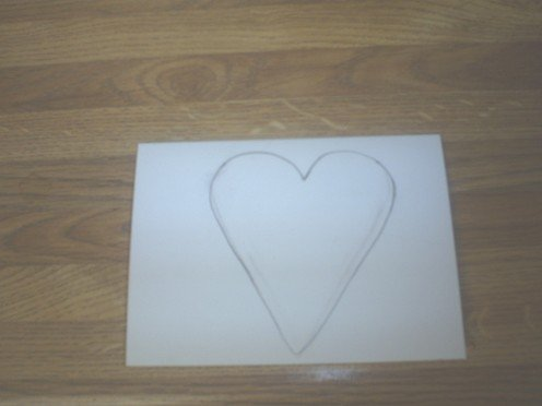 Draw a heart on the blank card.