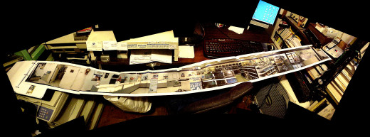 An uncropped, 5-photo panorama of an 8-foot-long printout of a  wall-to-wall indoor panorama. Folded inside of the black notebook, it is ready to show to anyone who doesn't run away from me and my wild photo enthusiasm.