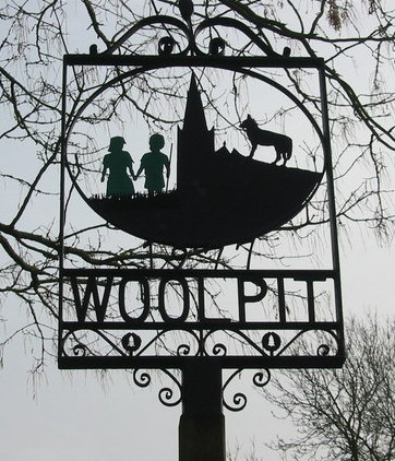 A sign commemorating the Green Children of Woolpit.