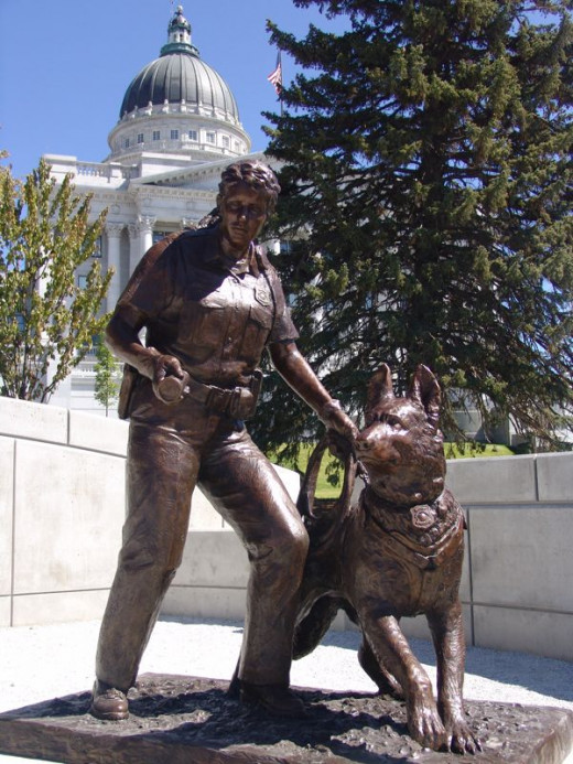 The Utah Law Enforcement Memorial, located near the Capital Building, has several bronze statues, one of which is a policewoman and her K-9 partner on duty