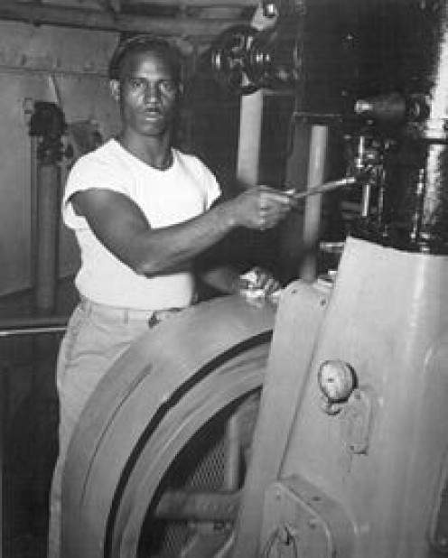 US merchant marine worker in a standard issue white T=shirt. circa 1940s