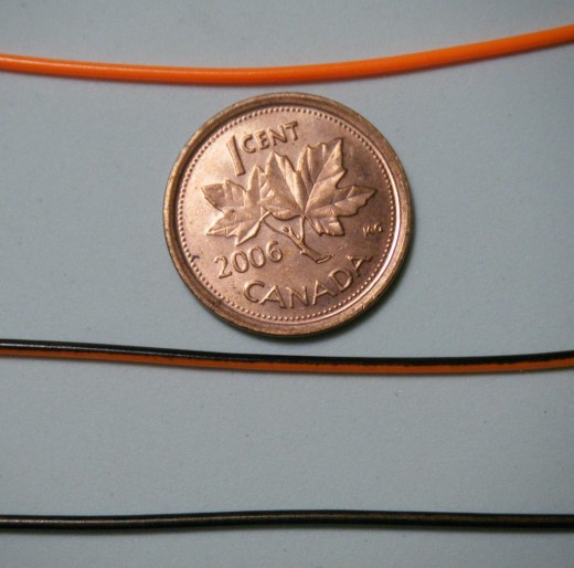 Three transitions of a sinking tip fly line.  Top: orange floating line, Middle: brown sinking line and orange floating line melded, Bottom: brown sinking line.