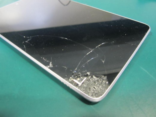 This troubled Nexus 7's bad owner dropped it, onto cement, from a moving car.
