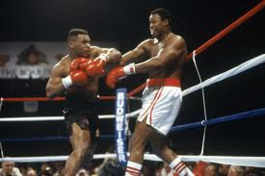 Iron Mike ravages Larry Holmes along the ropes en route to a fourth round knockout in defense of the heavyweight title.