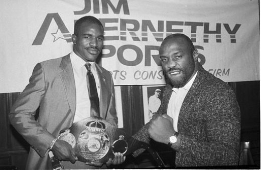 Evander Holyfield and Dwight Qwai fought twice for the Cruiserweight title with The Real Deal winning both times.