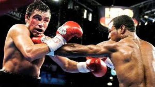 Sugar Shane Mosley has two wins over The Golden Boy Oscar De La Hoya. Mosley had eight title defenses in the 135 pound weight class and he won ll eight bouts by knockout.