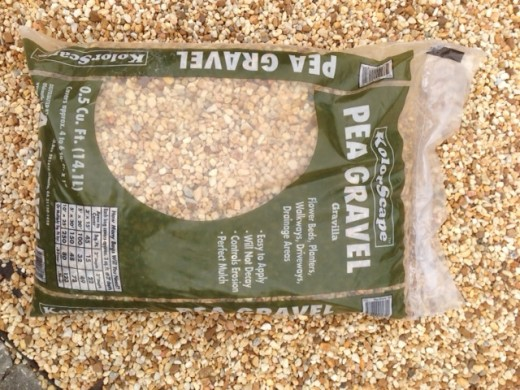one of eight, 50-pound pea gravel bags