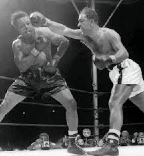 legendary Light Heavyweight boxer Archie Moore slips a right hand from Rocky Marciano in heavyweight title bout.