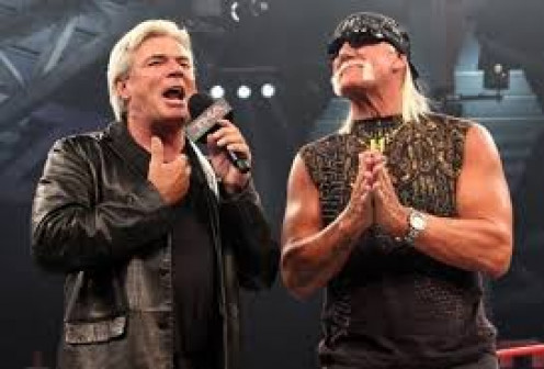 Eric Bischoff was usually on the side of the heels. He is seen here with Hollywood Hogan of the NWO.