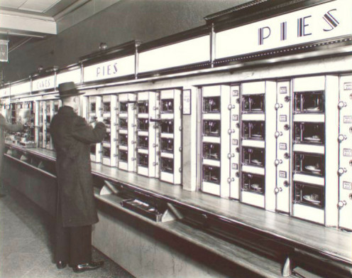 A man selects a piece of pie in an automat in 1936