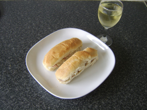 Turkey, mustard and chive mini sub rolls served with a glass of chilled white wine