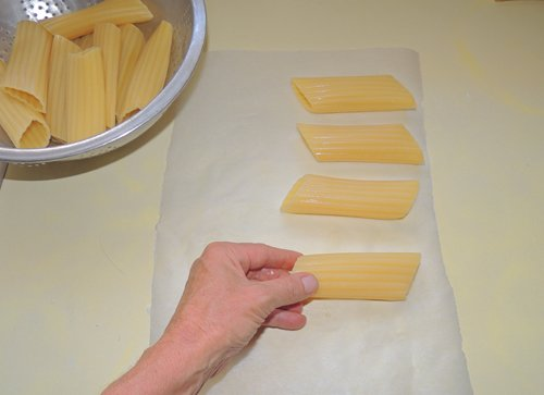your shells should be al dente by now - remove them, pat lightly dry, and place on clean surface