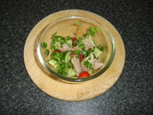Turkey is mixed through the watercress salad
