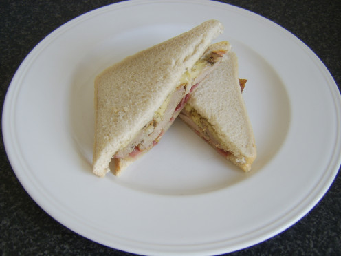 Fried bacon, refried turkey thigh and melted cheddar cheese sandwich