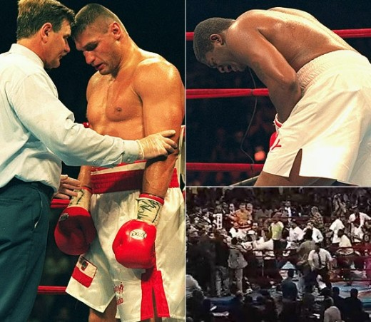 The ref takes a point from Andrew Golota for landing a low blow on Riddick Bowe. After taking a couple of points for low blows your in danger of being disqualified.