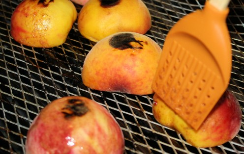 Brushing Peaches with Cinnamon Butter on the Grill.