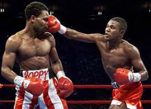 Felix Trinidad lands a big right hand on William Joppy. Lesson learned here: Keep your hands up at all times.