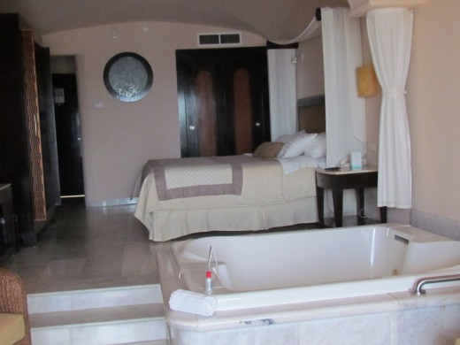 Our rooms at the Palace consist of a King size bed with sunken Jacuzzi tub surrounded by marble floors. Each room also comes with a fully stocked bar and refrigerator filled with a variety of drinks.