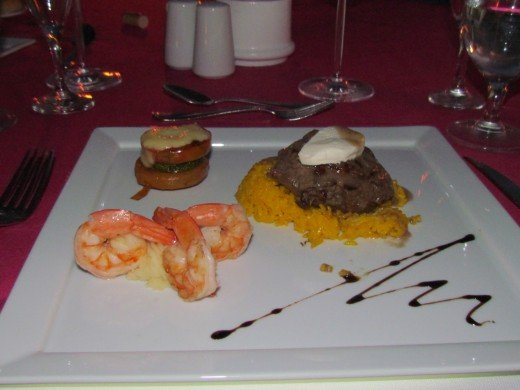 The delicious surf and turf meal we experienced during our romantic dinner on the beach.