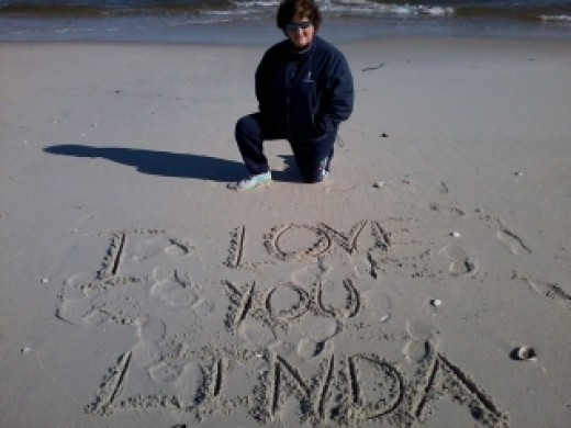 """THE OCEAN IS NOW MY HOME AND HERE I WRITE TO MY WIFE IN THE SAND OF THE BEACH..""""I LOVE YOU LINDA"""""""