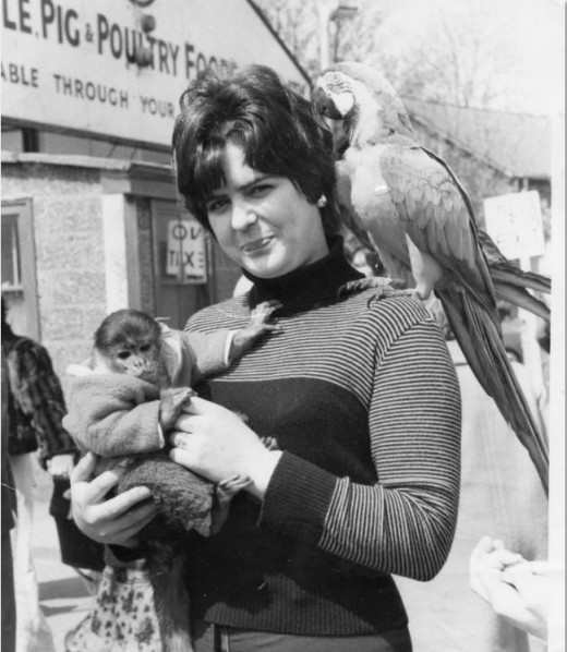 kathy and the monkey...and a parrot...I wonder if she paid extra