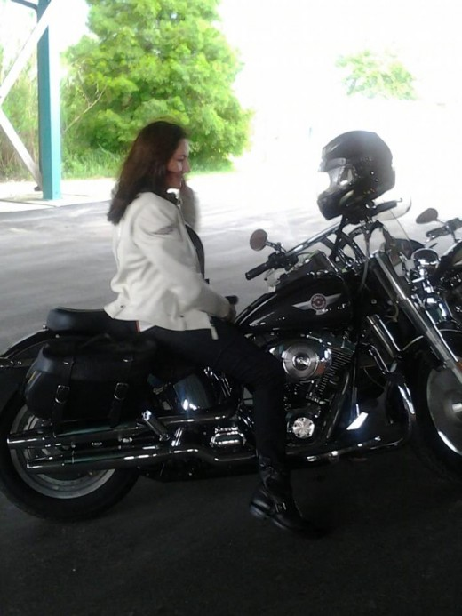 My sister on her Harley.  She takes after my mother with her dark hair.