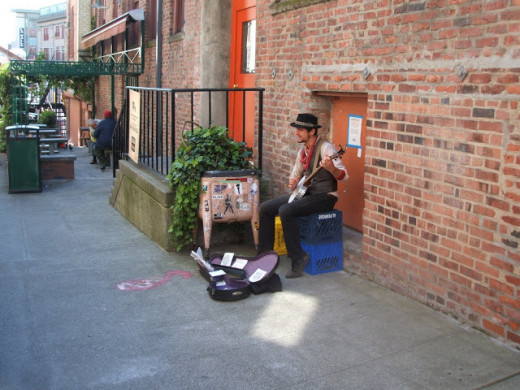 One of the many Market minstrels.