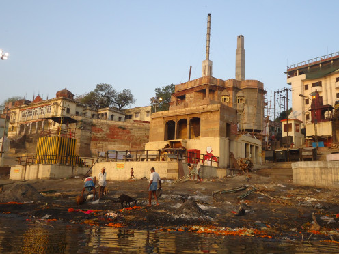 Piles of human ash outside the State Crematorium next to the Ganges