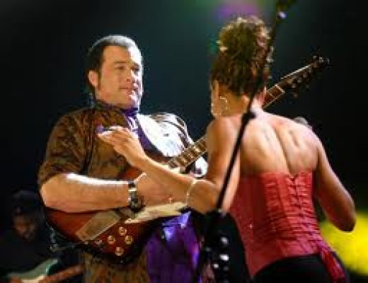 Steven Seagal on stage at a club playing the blues which is one of his favorite past times. He plays with passion just like he does with his martial arts and his acting.