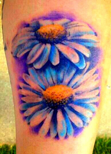 Painterly style of tattoo.