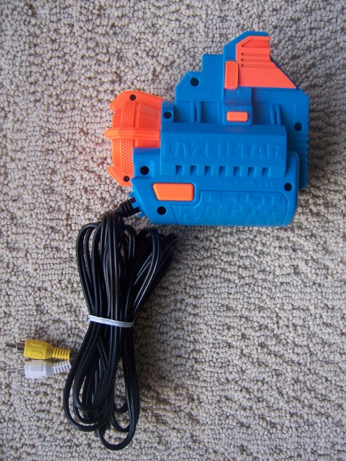 The video game module. This allows you to play on your TV and easily attaches Lazer Tagger to your TV, VCR, or DVD player via their video-in and audio-in jacks.