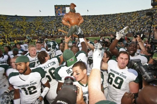 The Paul Bunyan Trophy, in the hands of the Spartans