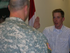 My husband swearing our son into the National Guard
