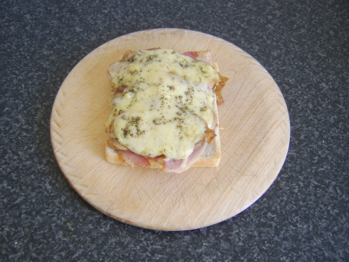 Leftover turkey, bacon and cheese melt sandwich ready to be topped and served