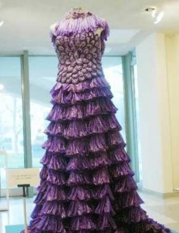 "This wedding dress was made out of 12,500 individually dyed condoms to commemorate World AIDS Day by a seamstress in new York. It's as gynecologists say, ""Condoms are a girl's best friend..."""